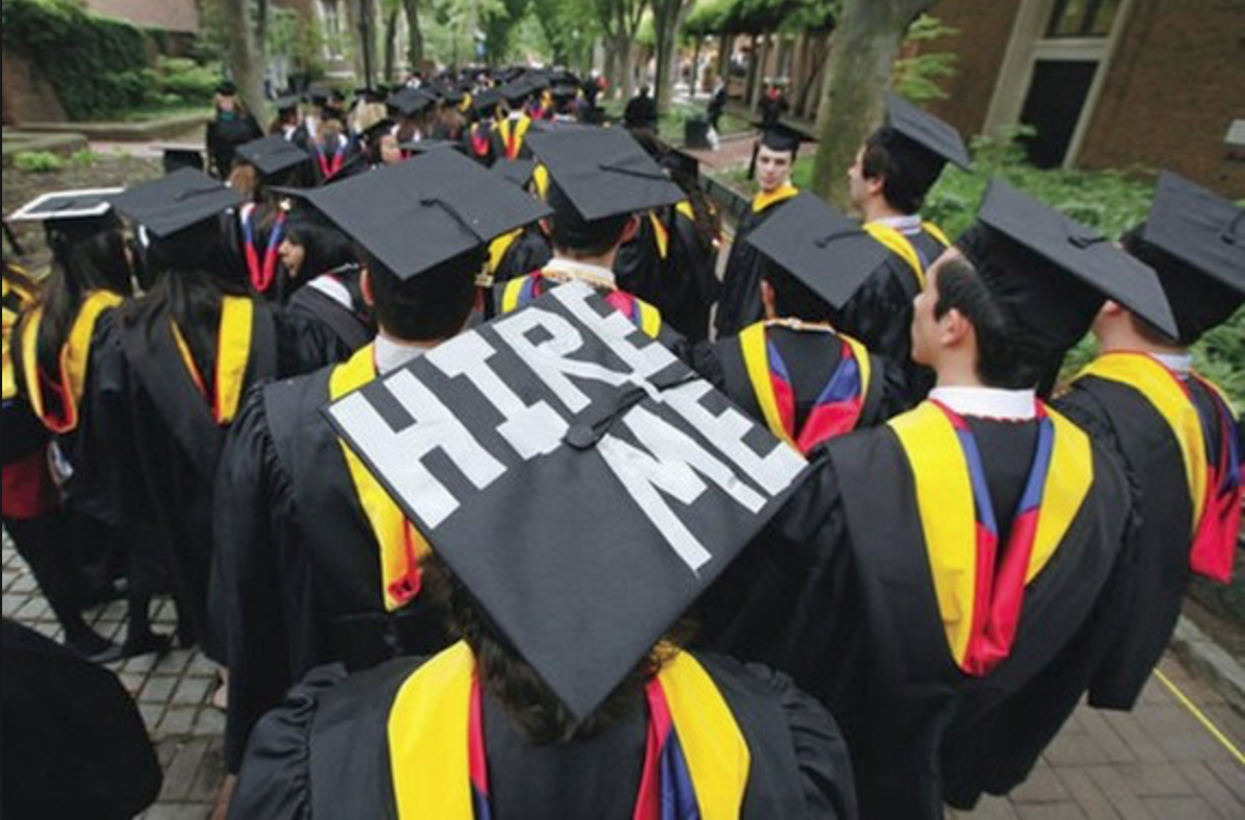 image of graduate with graduation hat that says hire me