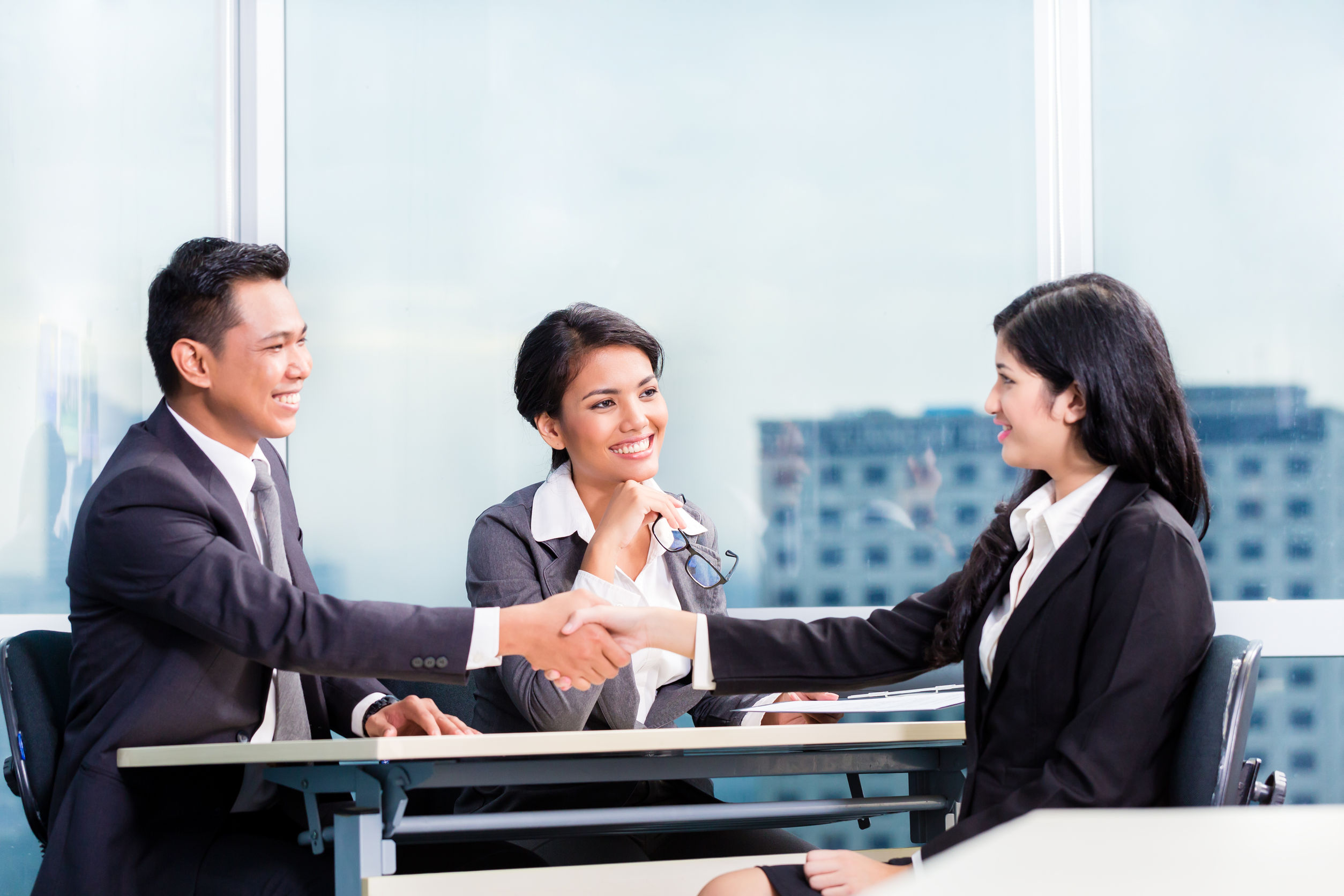 image of interview session with interviewee and two interviewers